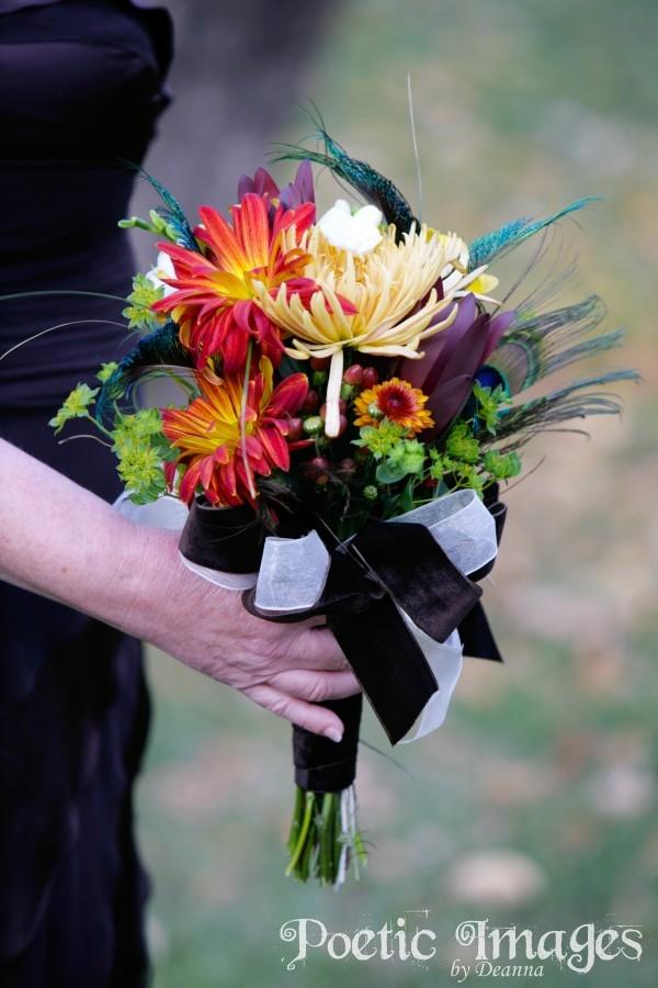 wedding flowers with orange, yellow, peacock