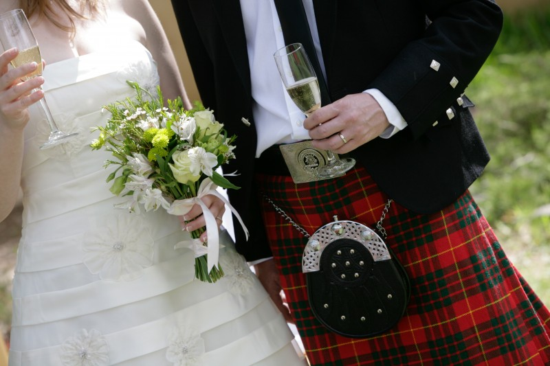 Bouquet, champagne, wedding dress, and Kilt