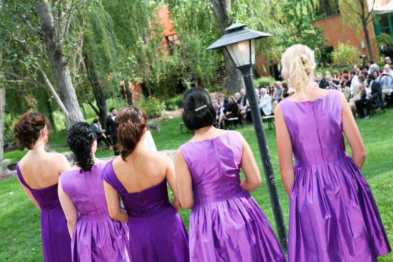purple bridesmaid dresses and flowers