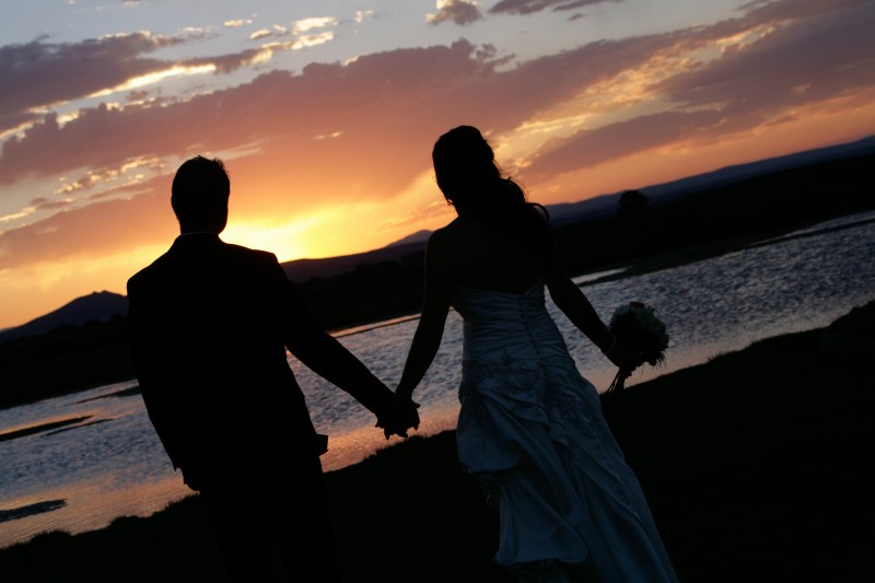 Sunset silhouettes on wedding day